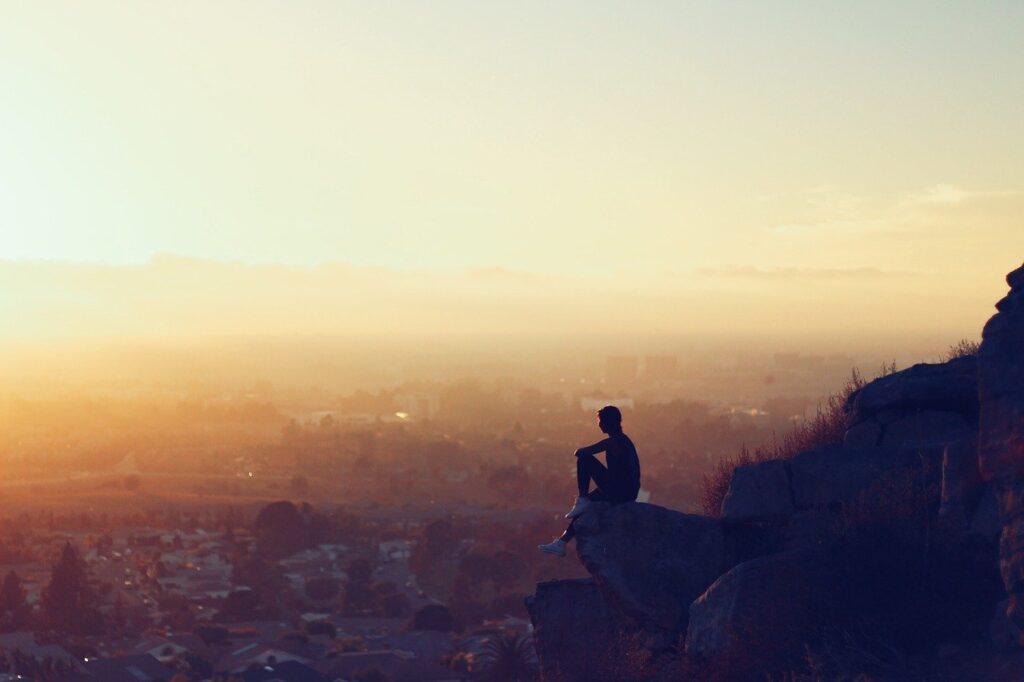 man, sitting, cliffs