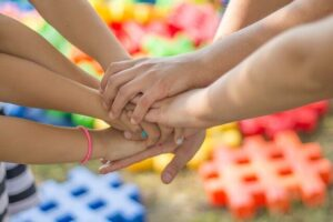 Children holding hands | 5 Supreme levels of Maslow's Hierarchy Theory and a Unique Approach by Krescon | krescon.com